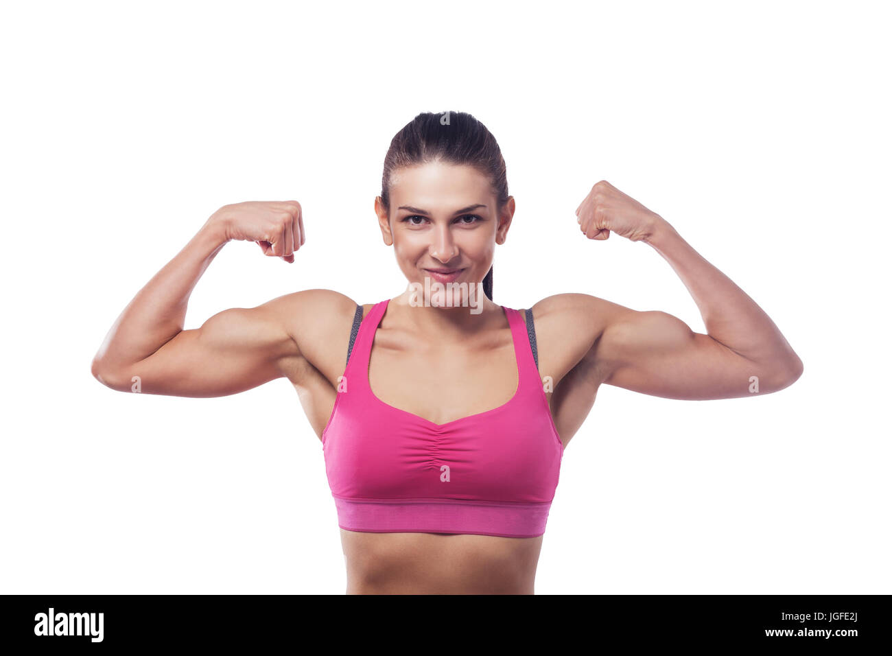 6c23eb4fdc402 A woman in pink sports clothes shows her bicep. Isolated white background -  Stock Image