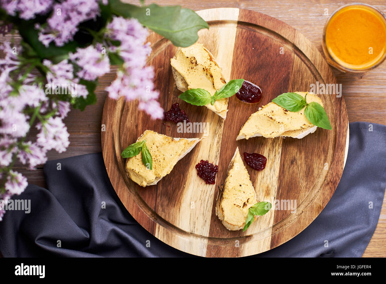 Toasts with chicken pate and onion confiture - Stock Image