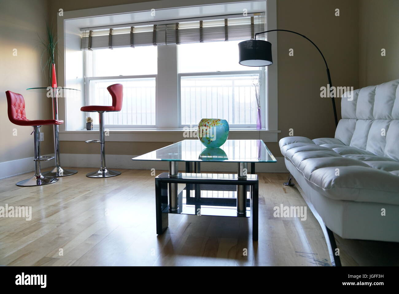 2 Glass Dining Table 2 Red Chair 1 Sofa In The Dining Room Or Stock Photo Alamy