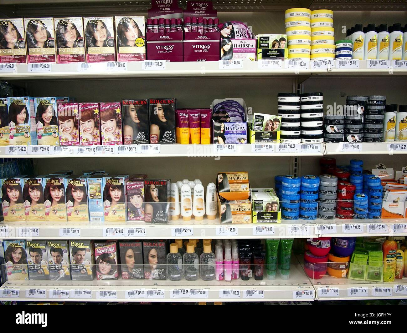 ANTIPOLO CITY, PHILIPPINES - JULY 5, 2017: Hair care products on display at a grocery store ready to be picked up - Stock Image