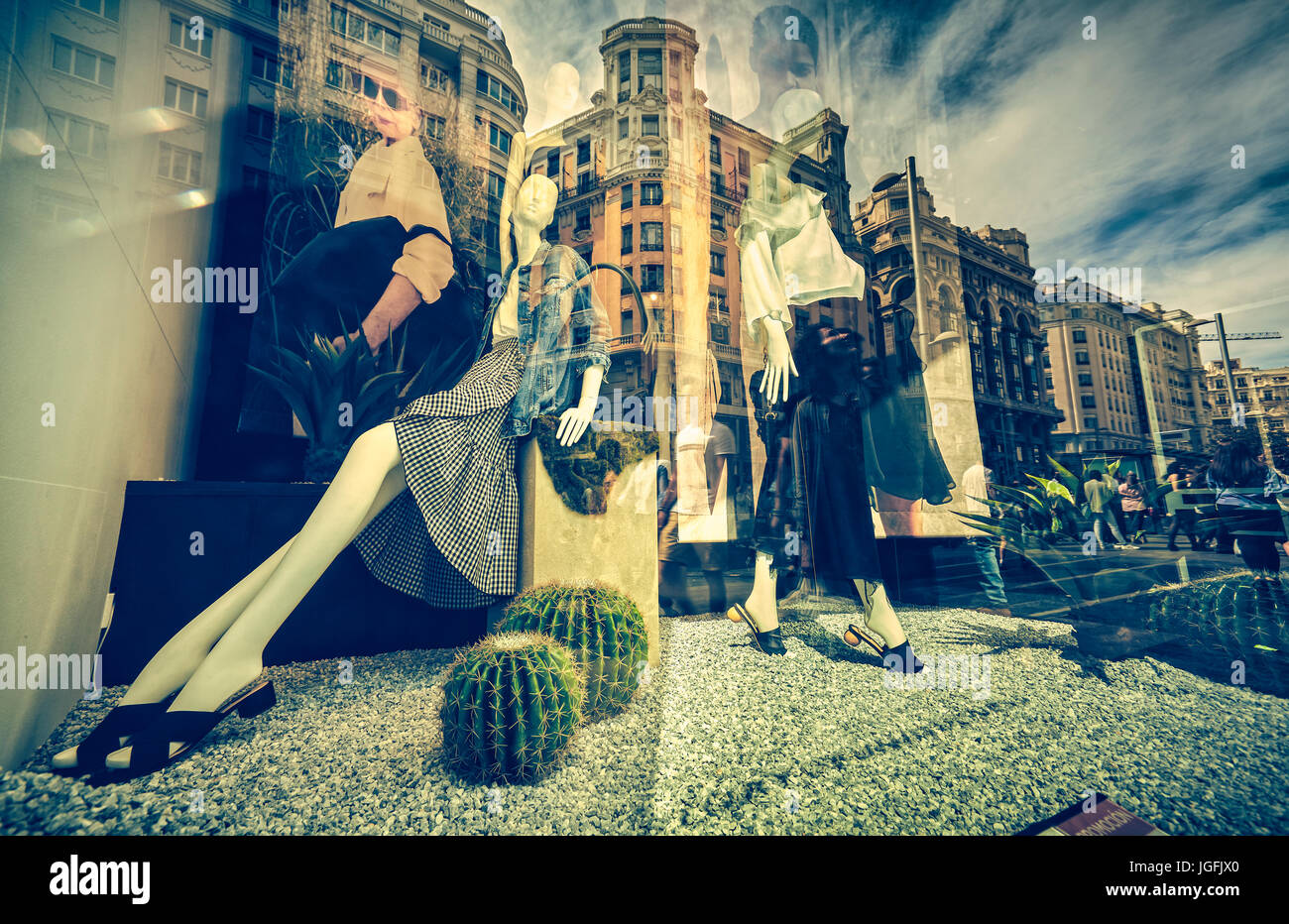 Mannequins and reflections at a window shop in Gran Via avenue. Madrid. Spain. - Stock Image