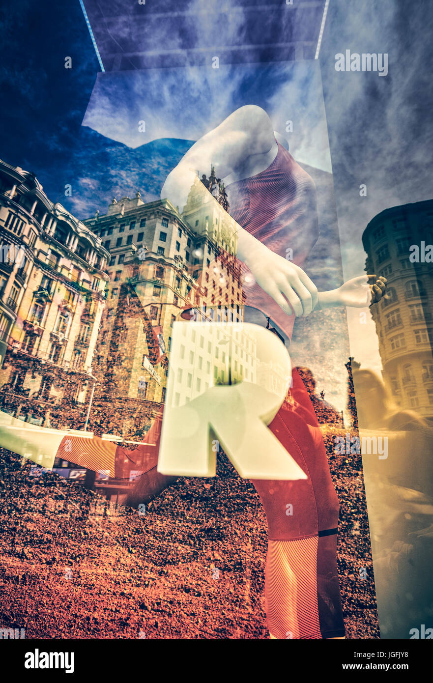 Mannequins and reflections at a window shop in Gran Via avenue. Madrid. Spain - Stock Image