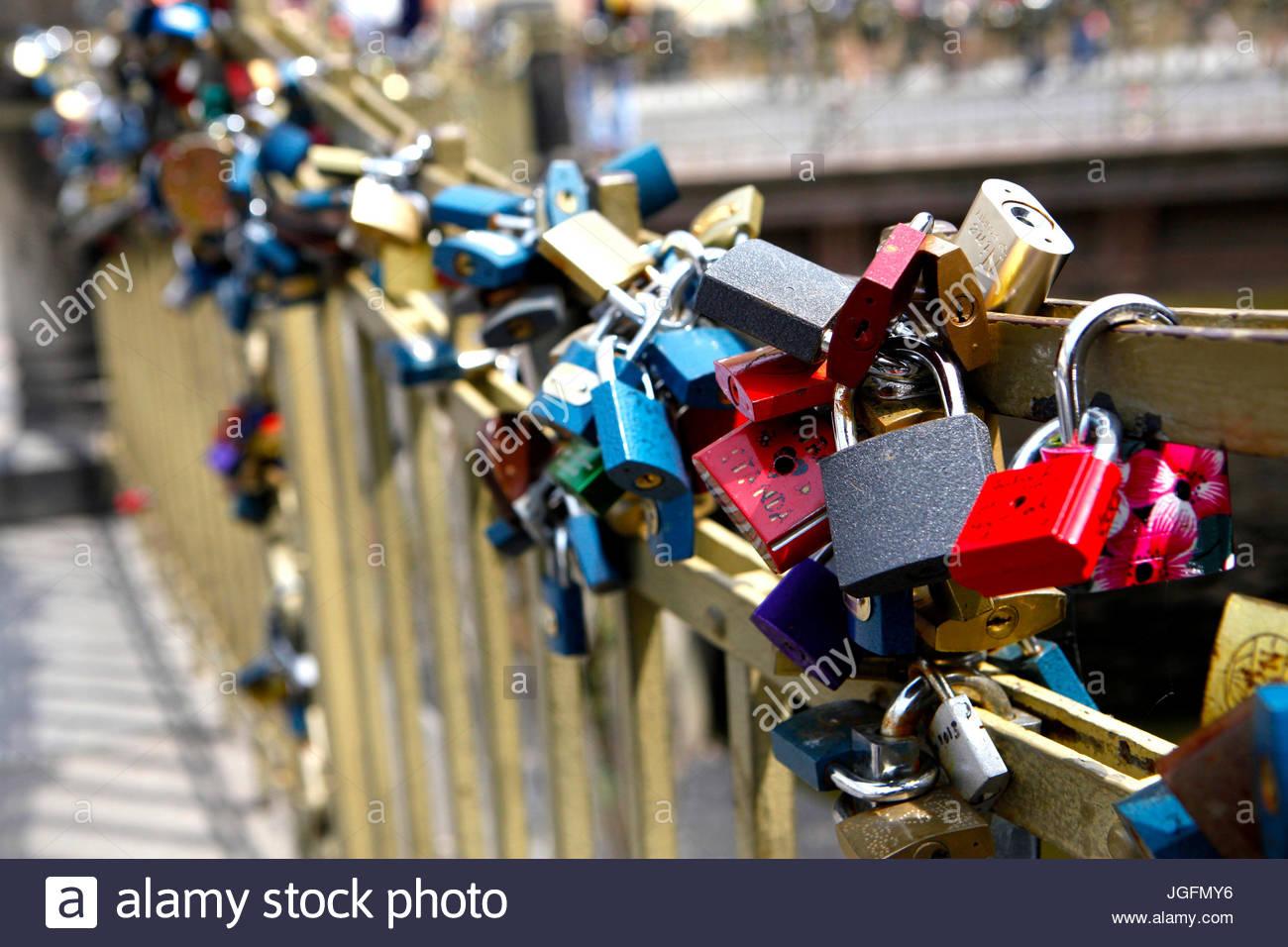 Padlocks have attached to a bridge near the Charles Bridge symbolize love. - Stock Image