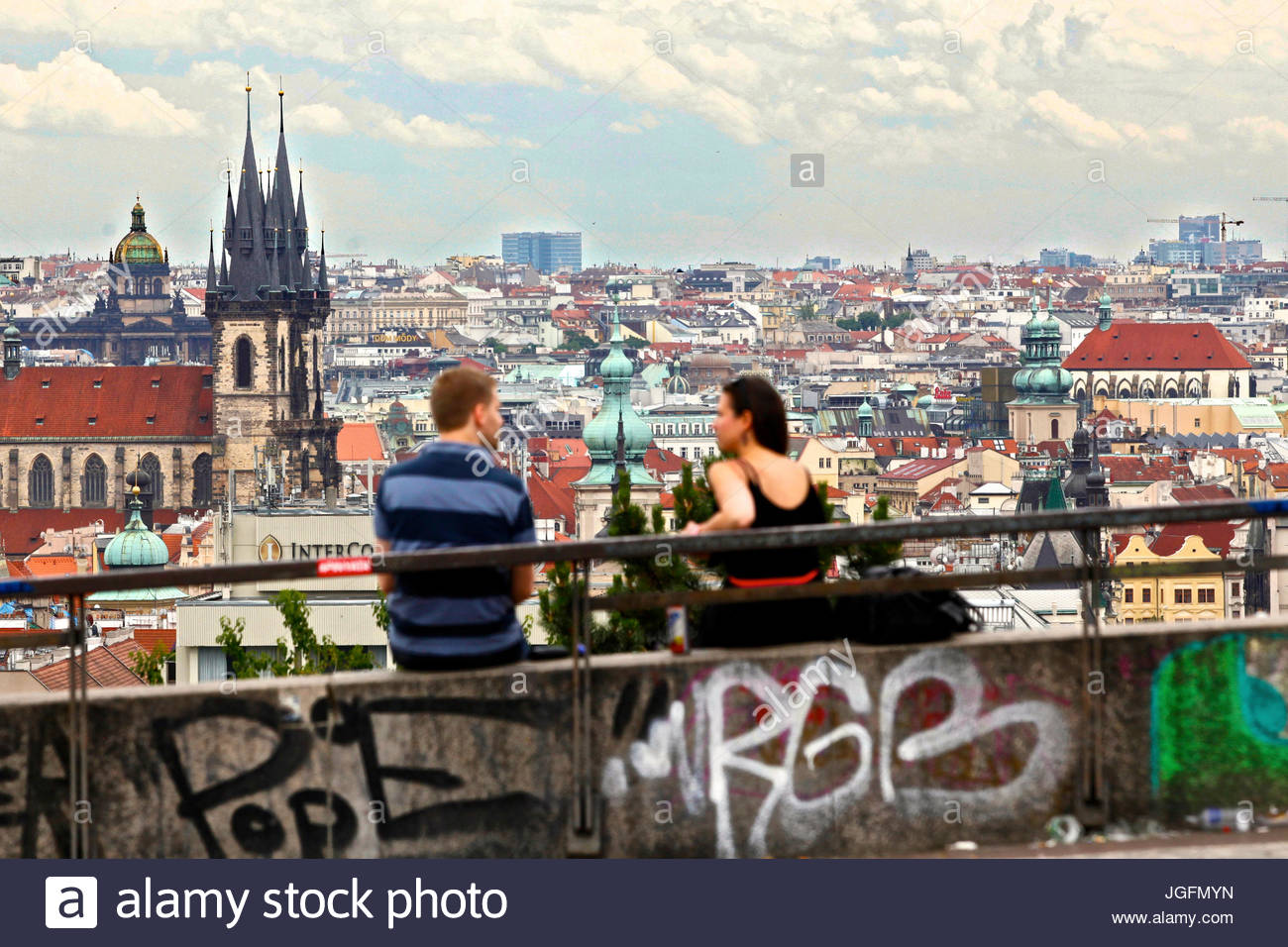 A couple admires panoramic views of Prague from Letna Park. - Stock Image