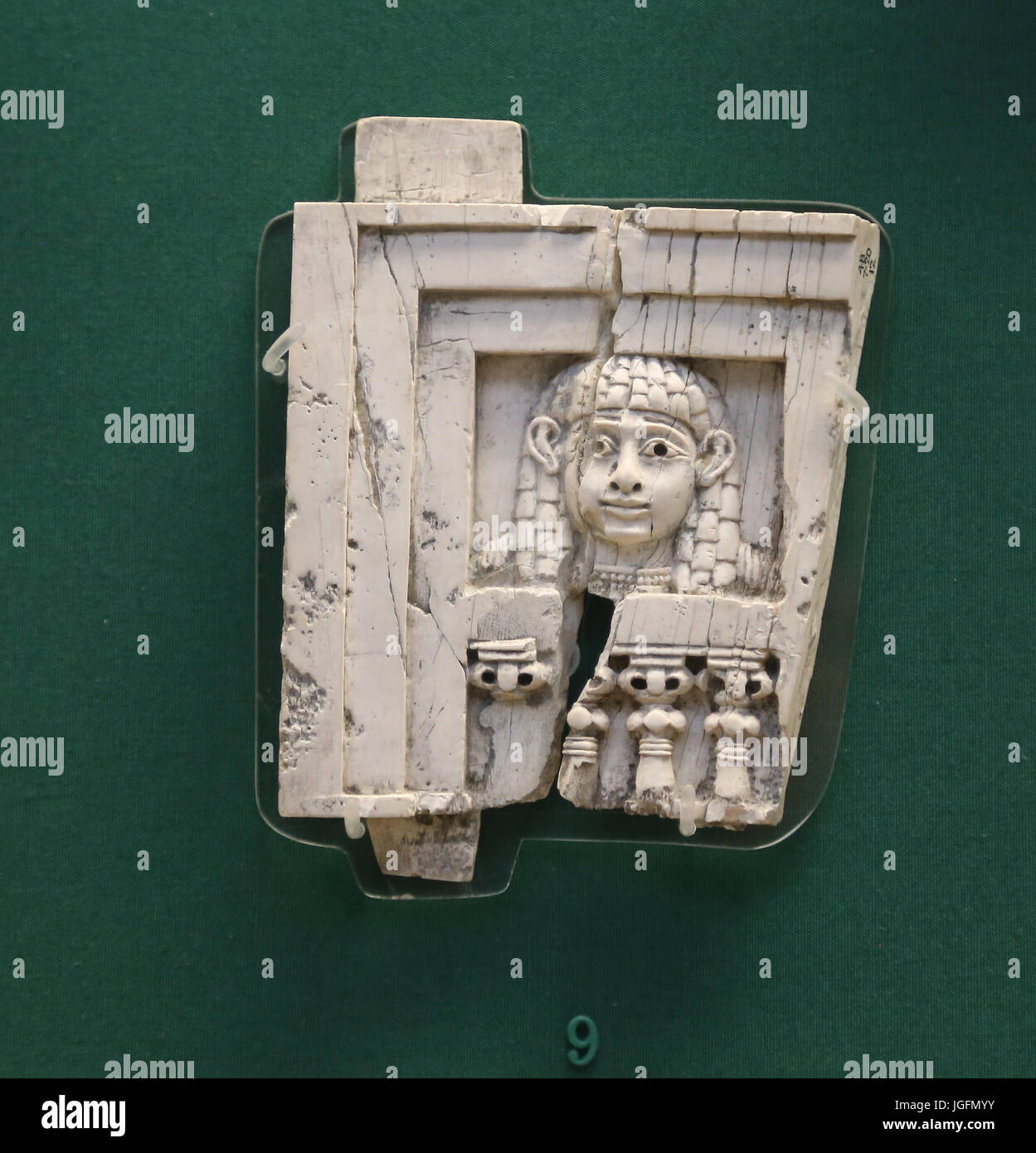 Woman at the window. Phoenician. Ivory from Nimrud, Iraq. 8th BCE. Iraq. British Museum. London. UK. - Stock Image