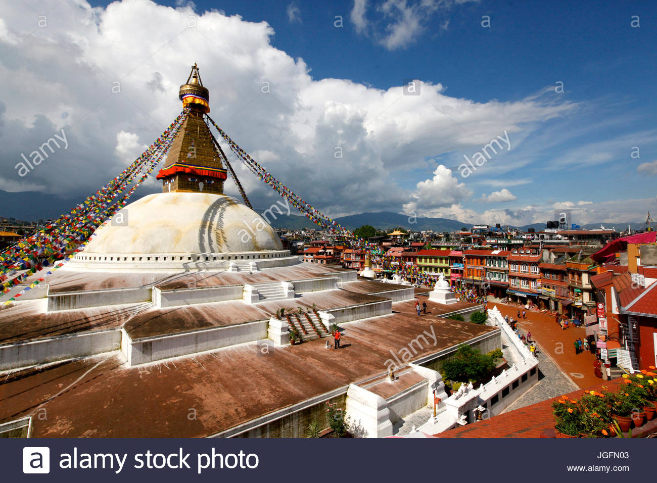 View of Boudhanath Stupa from one of the many rooftop restaurants surrounding it. - Stock Image