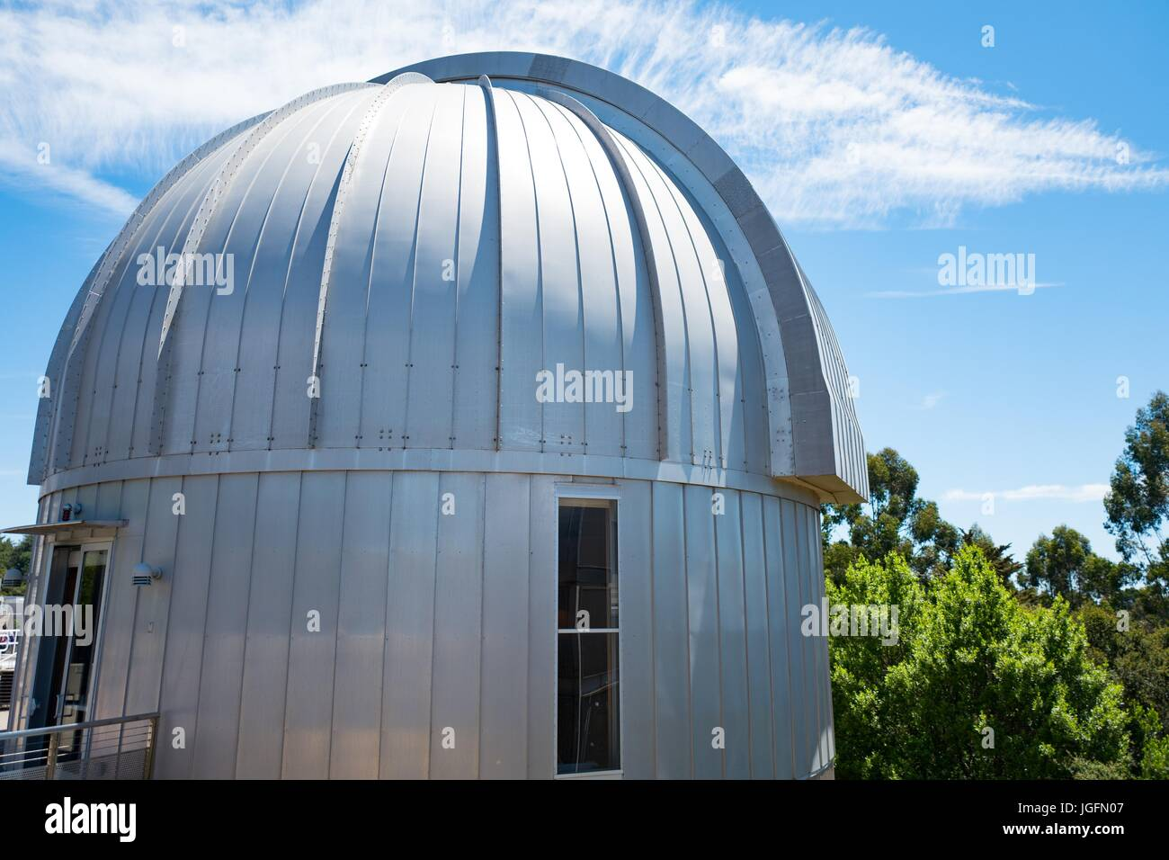 Dome of an observatory on a sunny day at the Chabot Space and Science Center, a science museum and observatory in - Stock Image