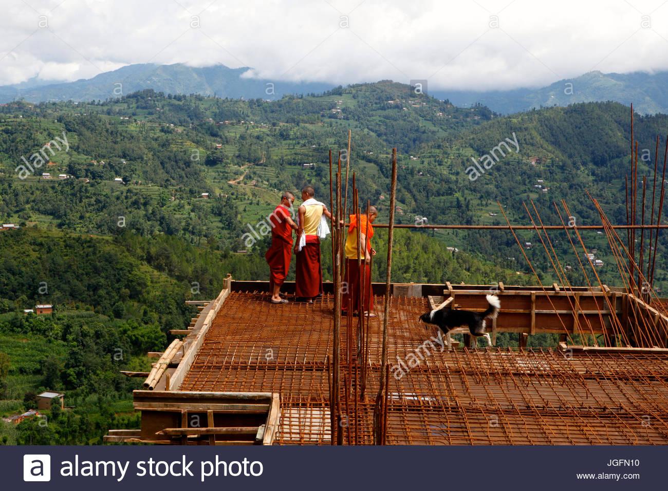 Monks do construction work at Namo Buddha monastery. - Stock Image