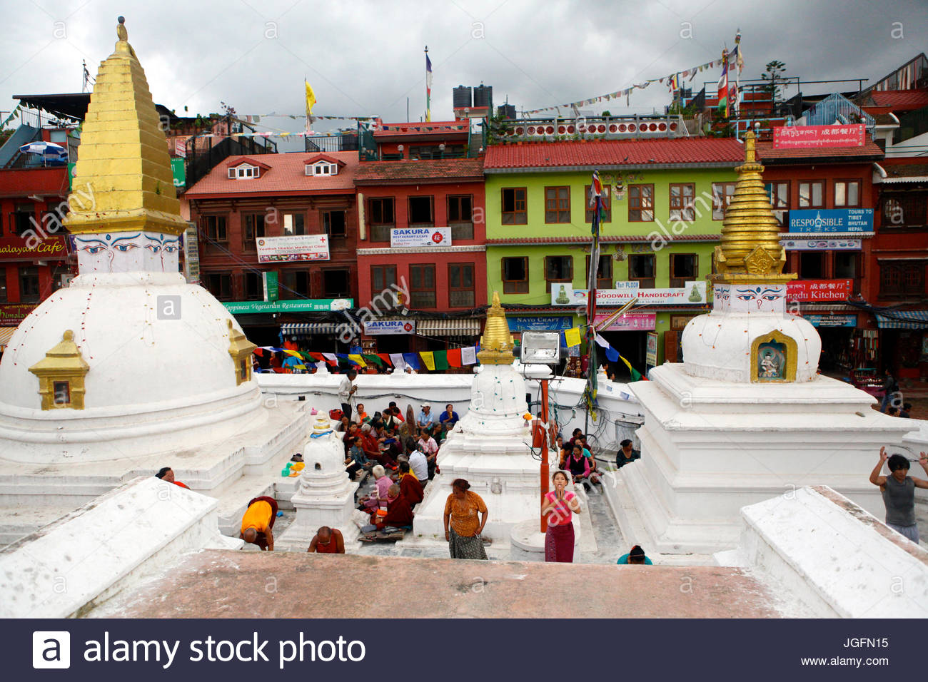 View from Boudhanath Stupa of people prostrating (praying). - Stock Image