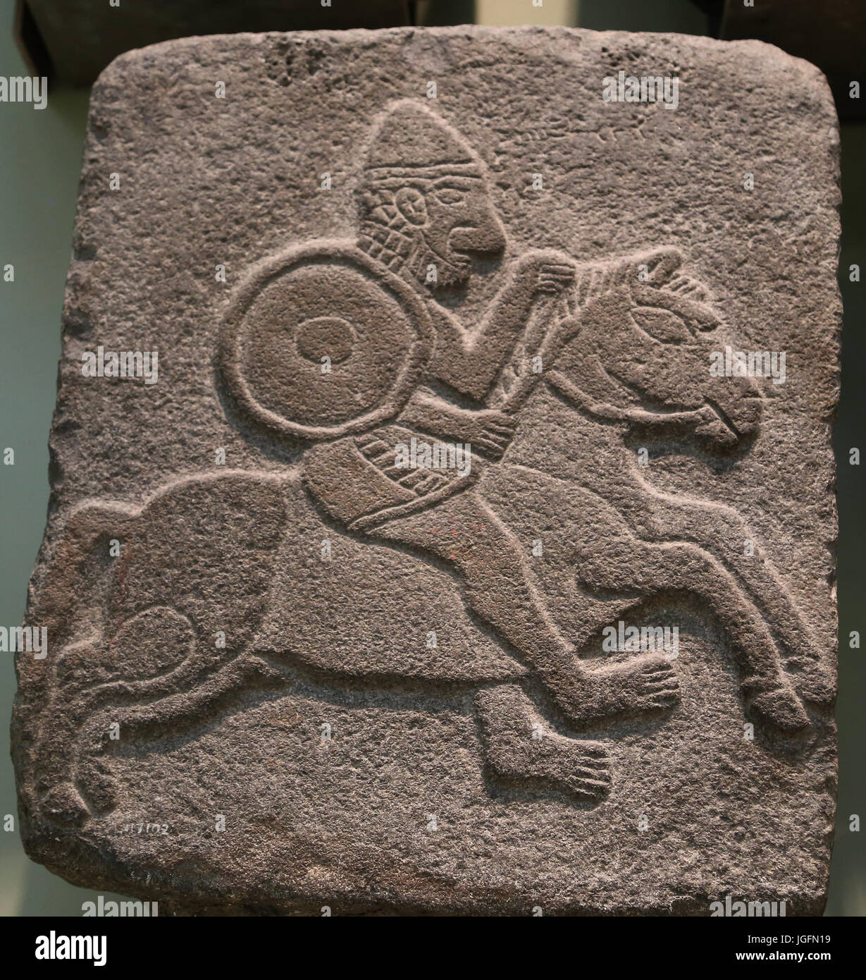 Basalt relief of soldier riding horse. 10th century BC. Middle East, Syria, Tel Halaf. British Museum. London. UK. Stock Photo