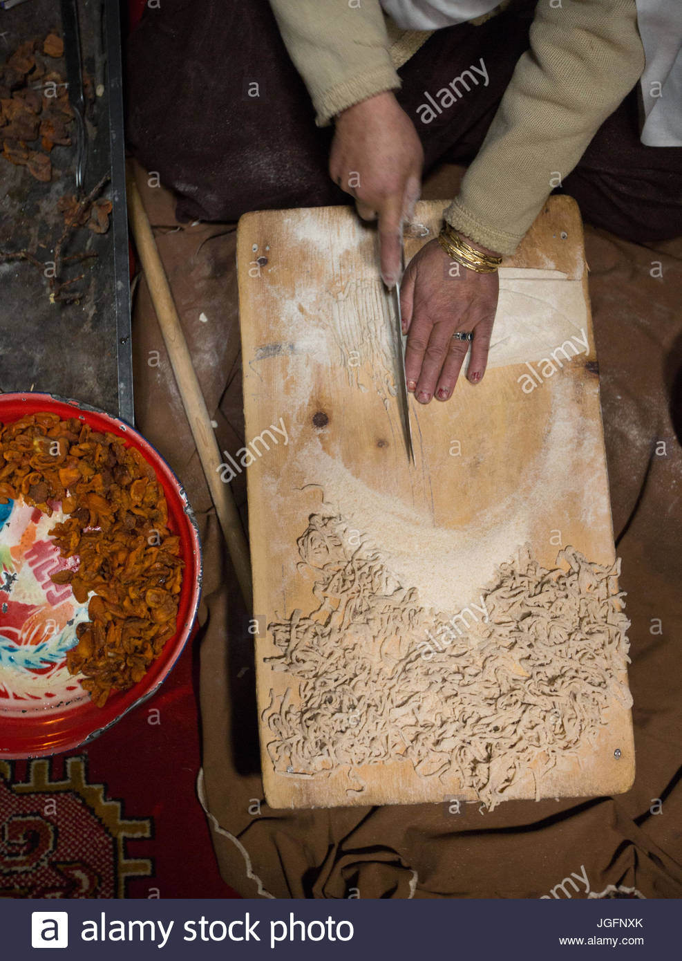 Making traditional apricot soup called Haneetze Doudo in a home in the Hunza Region. - Stock Image