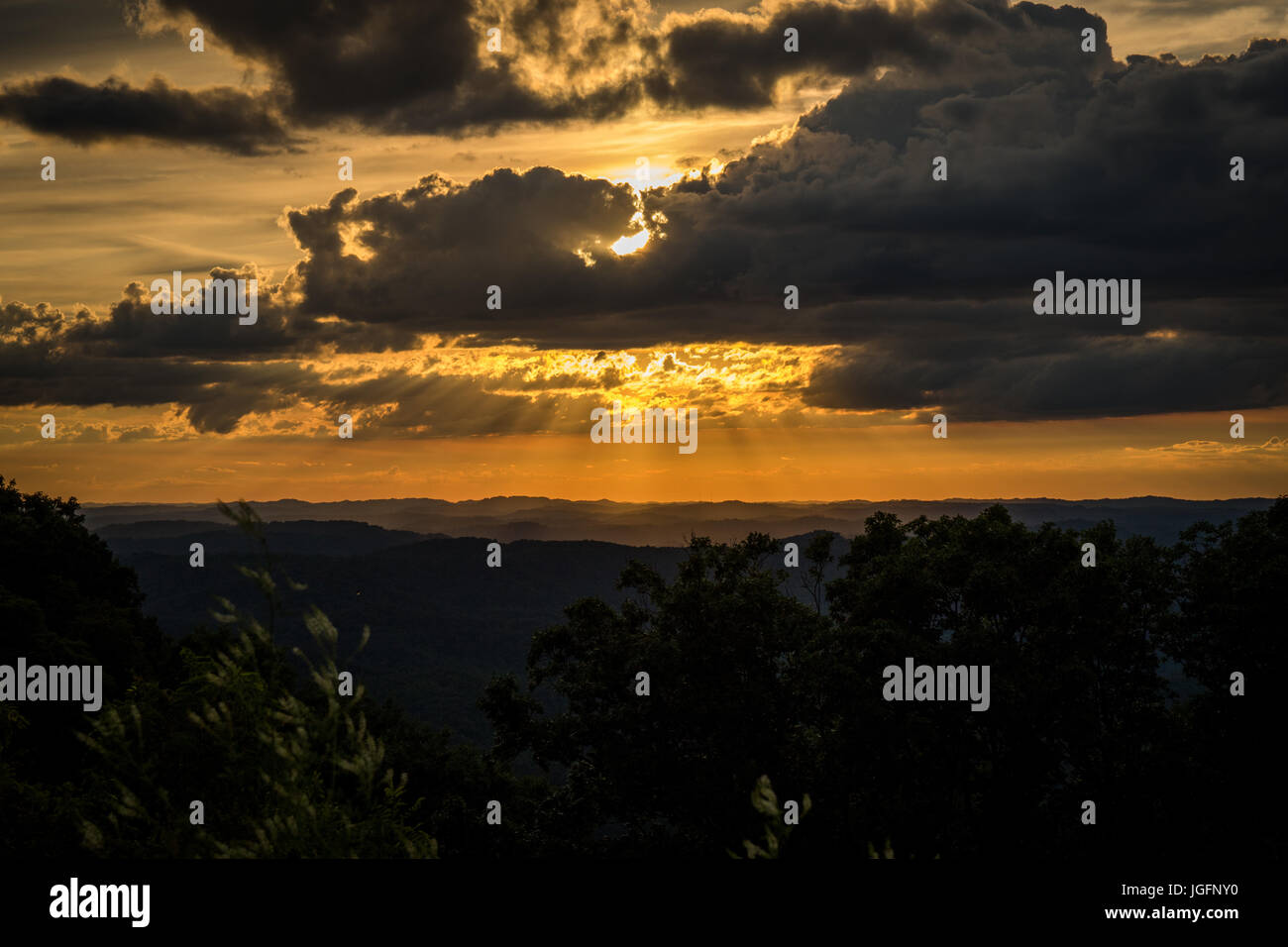 A sunset above the mountain in Central Appalachia. - Stock Image