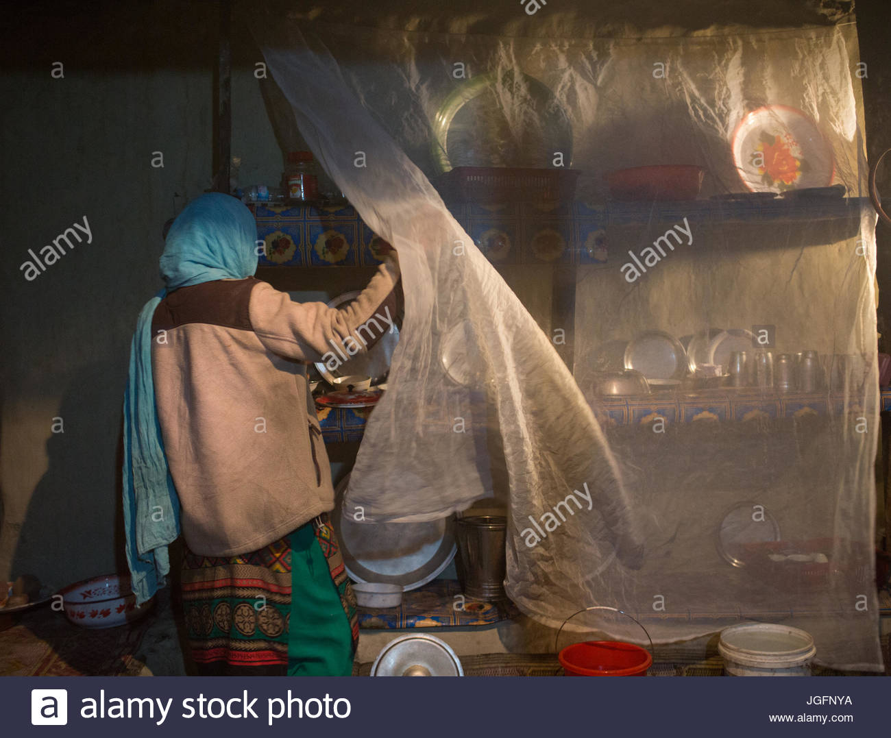 A woman in her kitchen in Passu, a village in the Gojal Region. Stock Photo