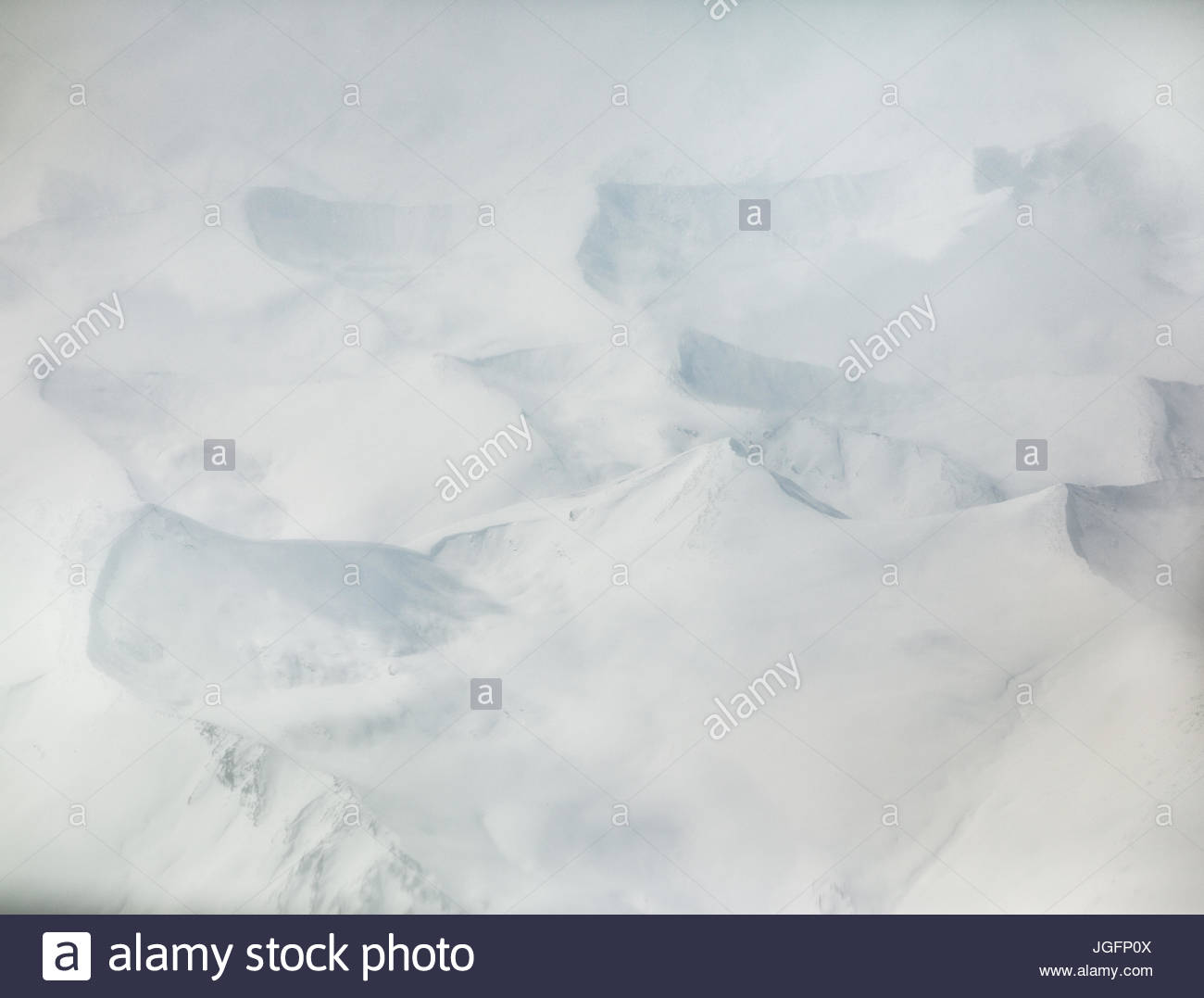 An aerial view over the Karakoram Mountains. - Stock Image