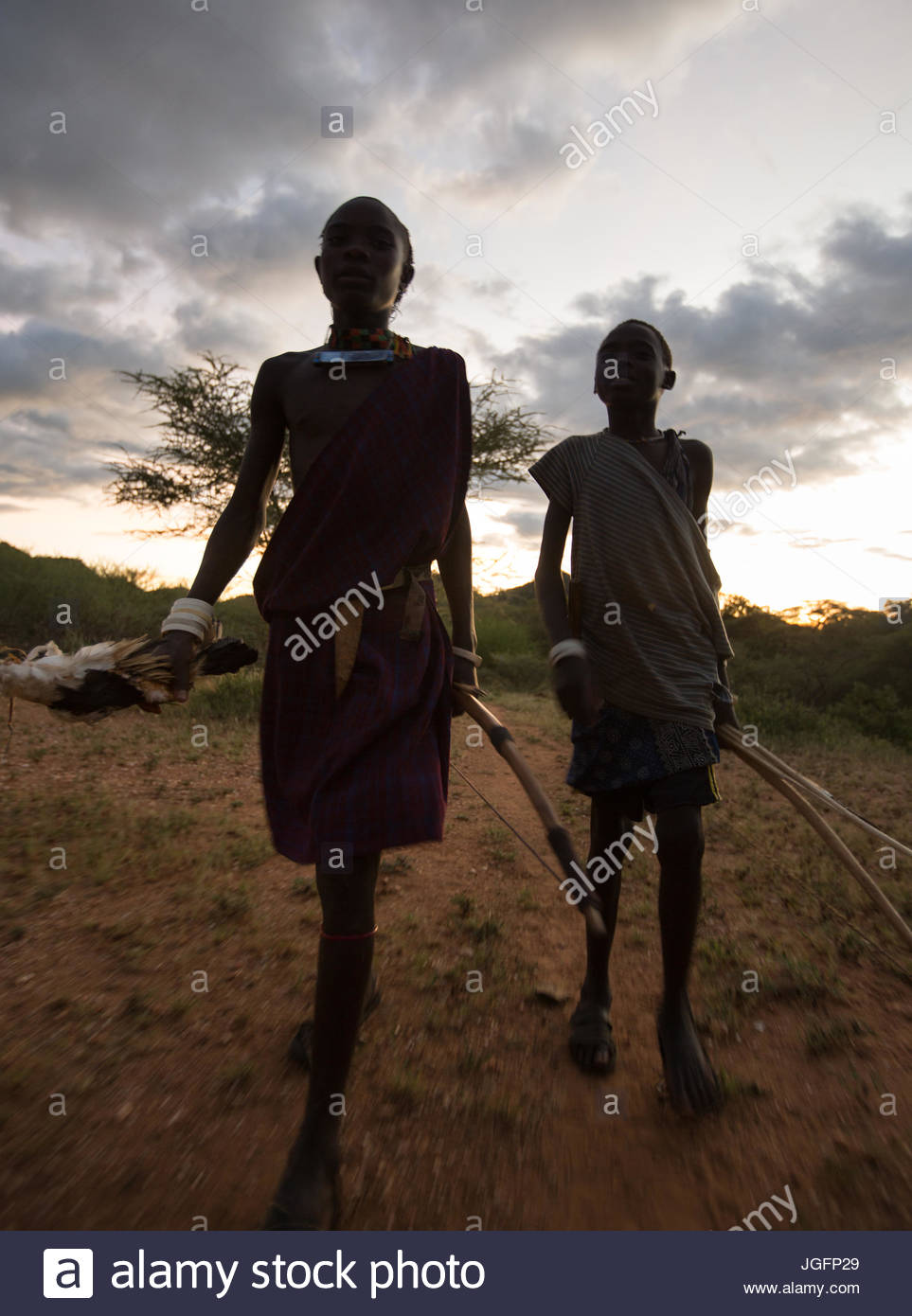 A Hadza Hunter And Pastoralist Walking At Twilight