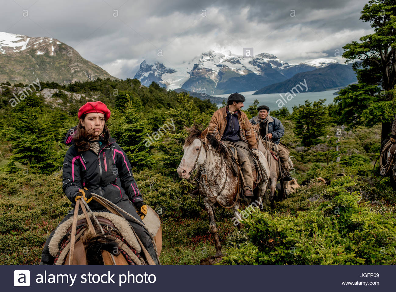 Bagualeros, cowboys who capture feral livestock, on an expedition with their dogs. - Stock Image