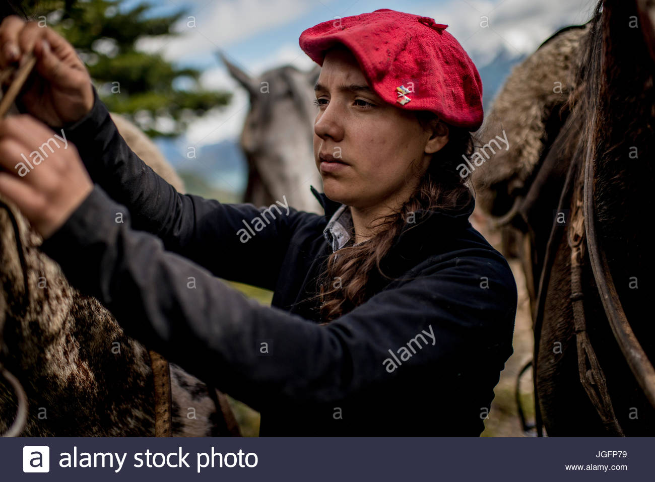 A woman pauses as she accompanies bagualeros, cowboys who capture feral livestock. - Stock Image