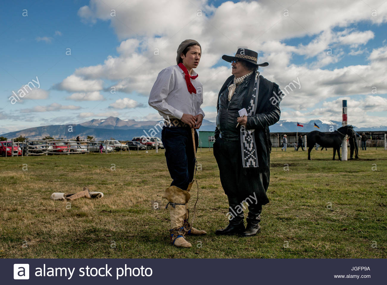 A rider talks to a 'tropillero' or owner of the feral horses on a ranch near Puerto Natales, Chile. - Stock Image