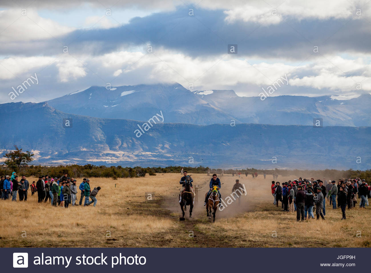 Horse racing during a Jineteada Festival on a ranch near Puerto Natales, Chile. - Stock Image