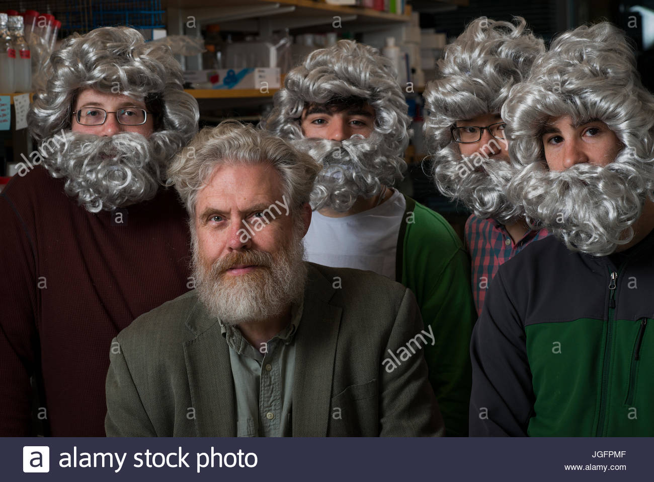 Initiator of The Human Genome Project, Dr. George Church, with post-graduate students who work in his lab, jokingly - Stock Image