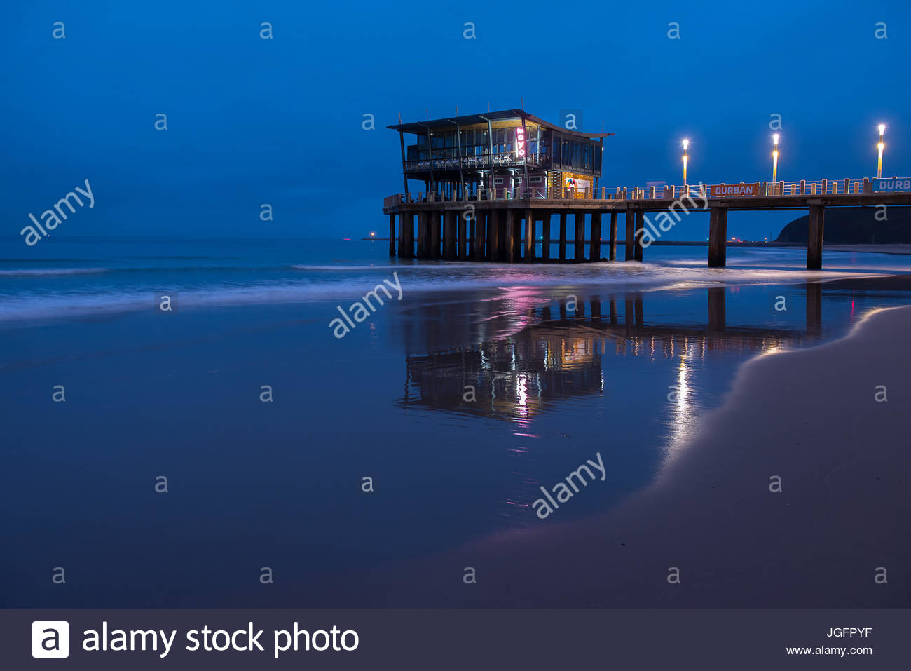 The two story glass Moyo Shaka restaurant offers diners unparalleled views of the Indian Ocean. - Stock Image