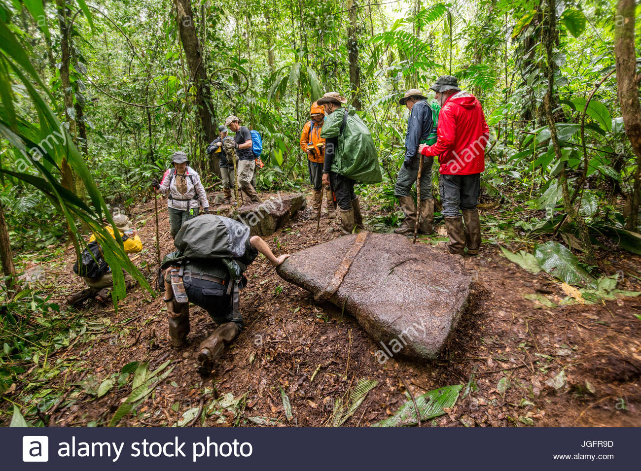 A scientific team inspects a construction stone that they believe was carved by members of a vanished civilization. - Stock Image