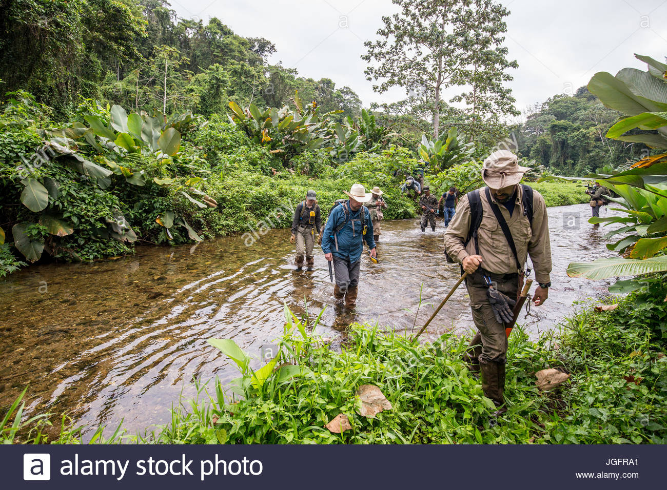 Members of a scientific team return to camp after a day exploring the ruins of a pre-Colombian city in the Mosquitia - Stock Image