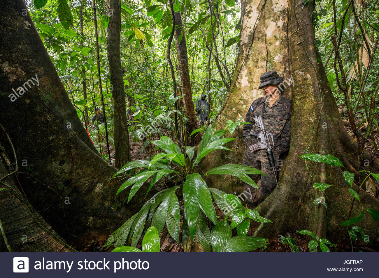 Honduran troops on an expedition to explore the ruins of a pre-Colombian city in the Mosquitia jungle. - Stock Image