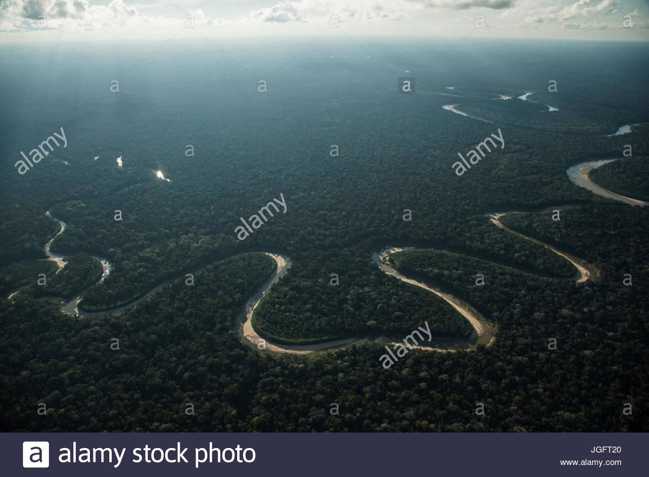 The Manu River flows in Manu National Park. - Stock Image