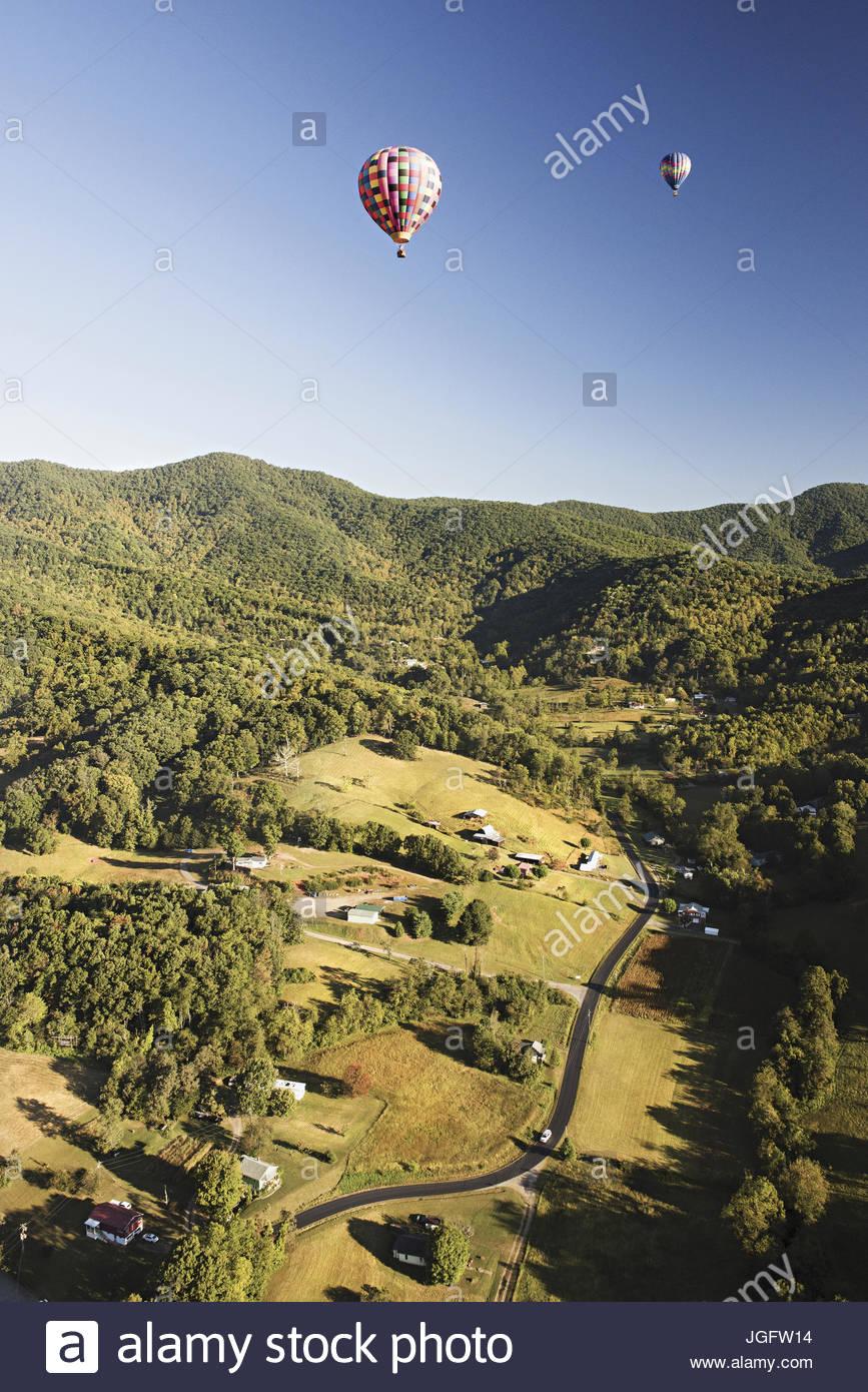 Asheville Hot Air Balloon takes passengers over the Blue Ridge Mountains. - Stock Image