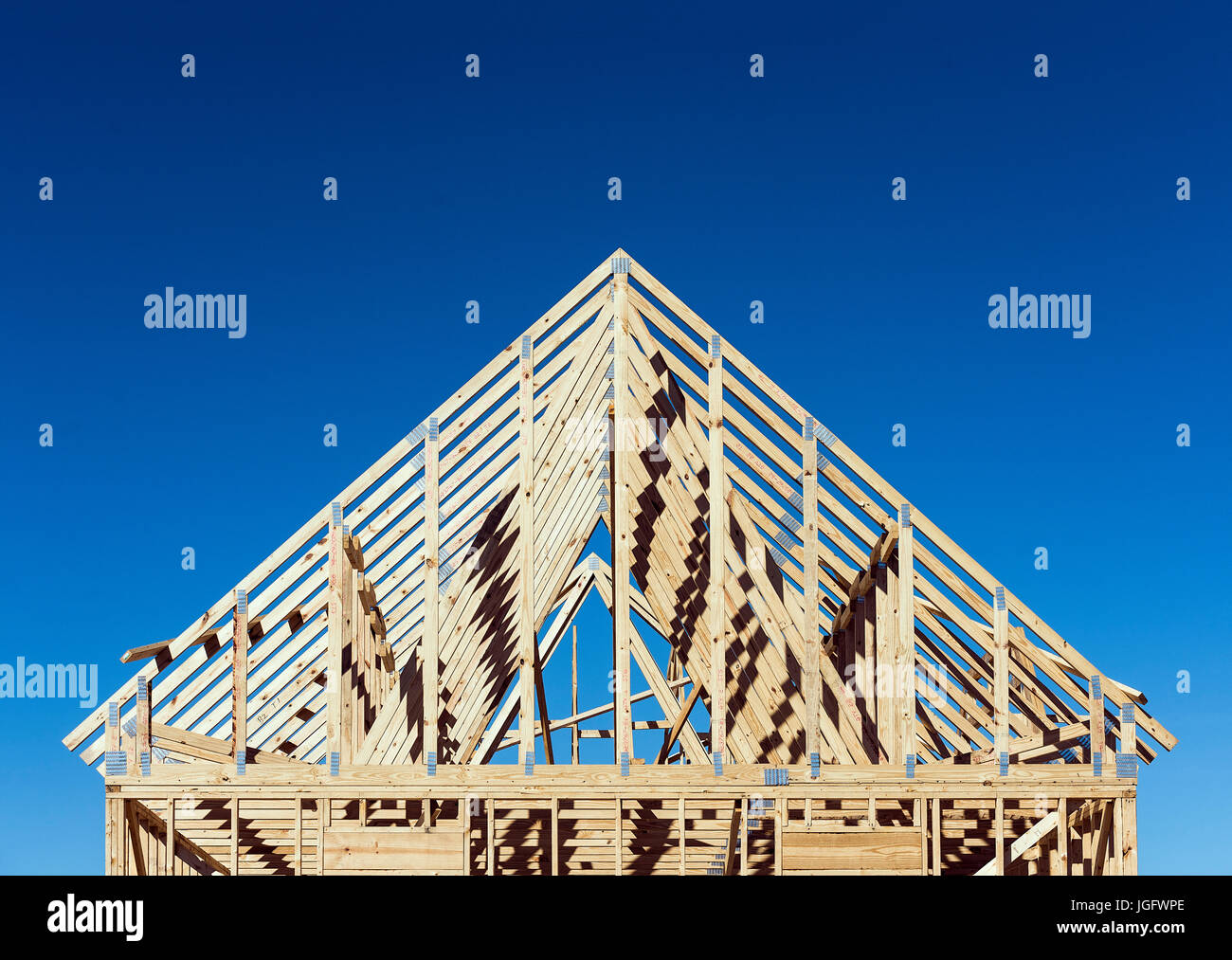 New construction house frame. - Stock Image