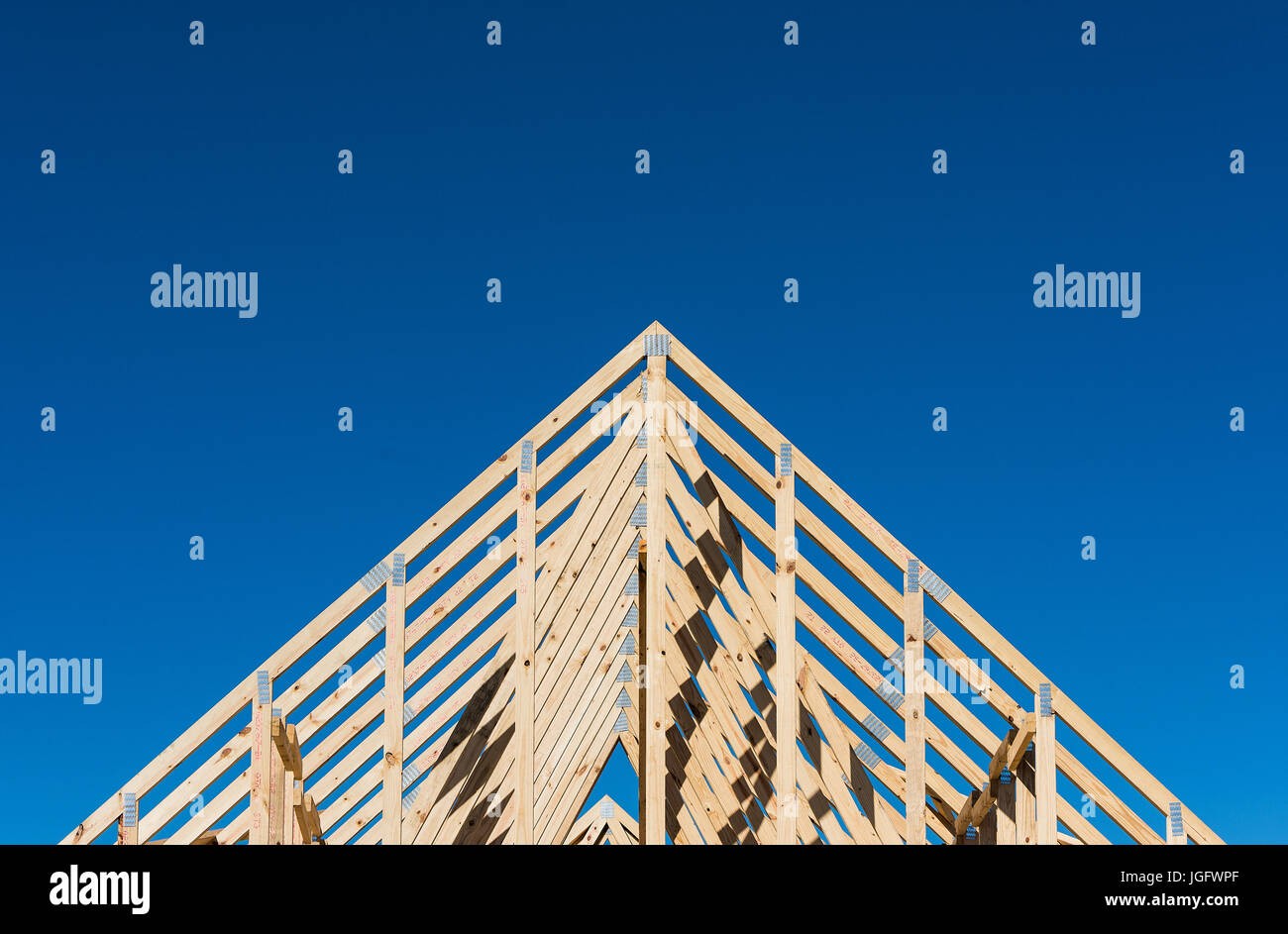 New construction house frame. Stock Photo