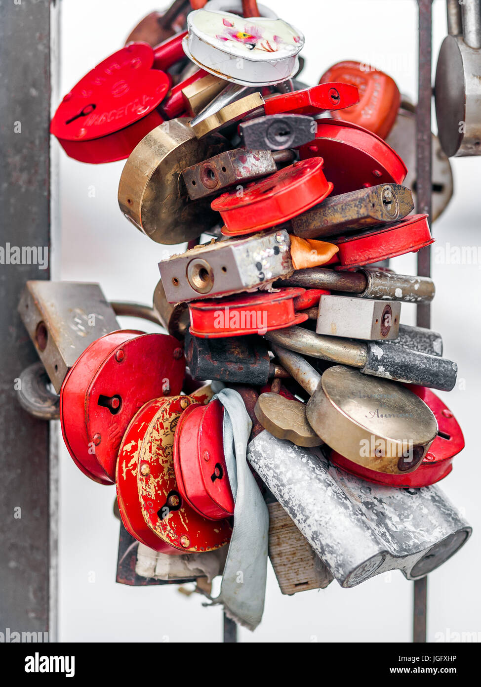 Bunch of padlocks. There are a lot of padlocks connected together. Different colors. Red, yellow, gold, silver. - Stock Image