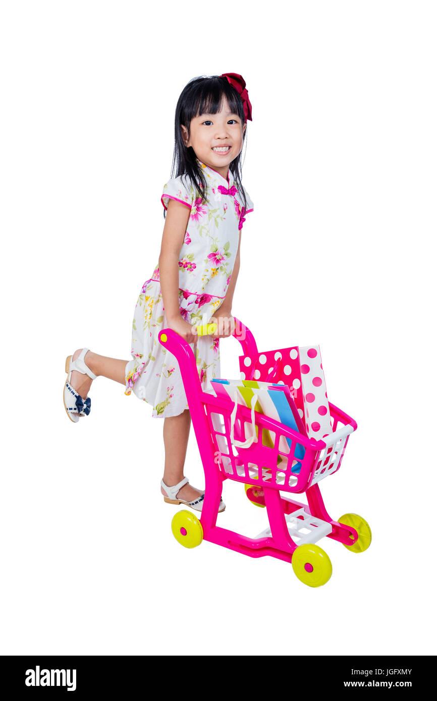 a445098743b8 Asian Chinese little girl wearing cheongsam pushing toy trolley in ...