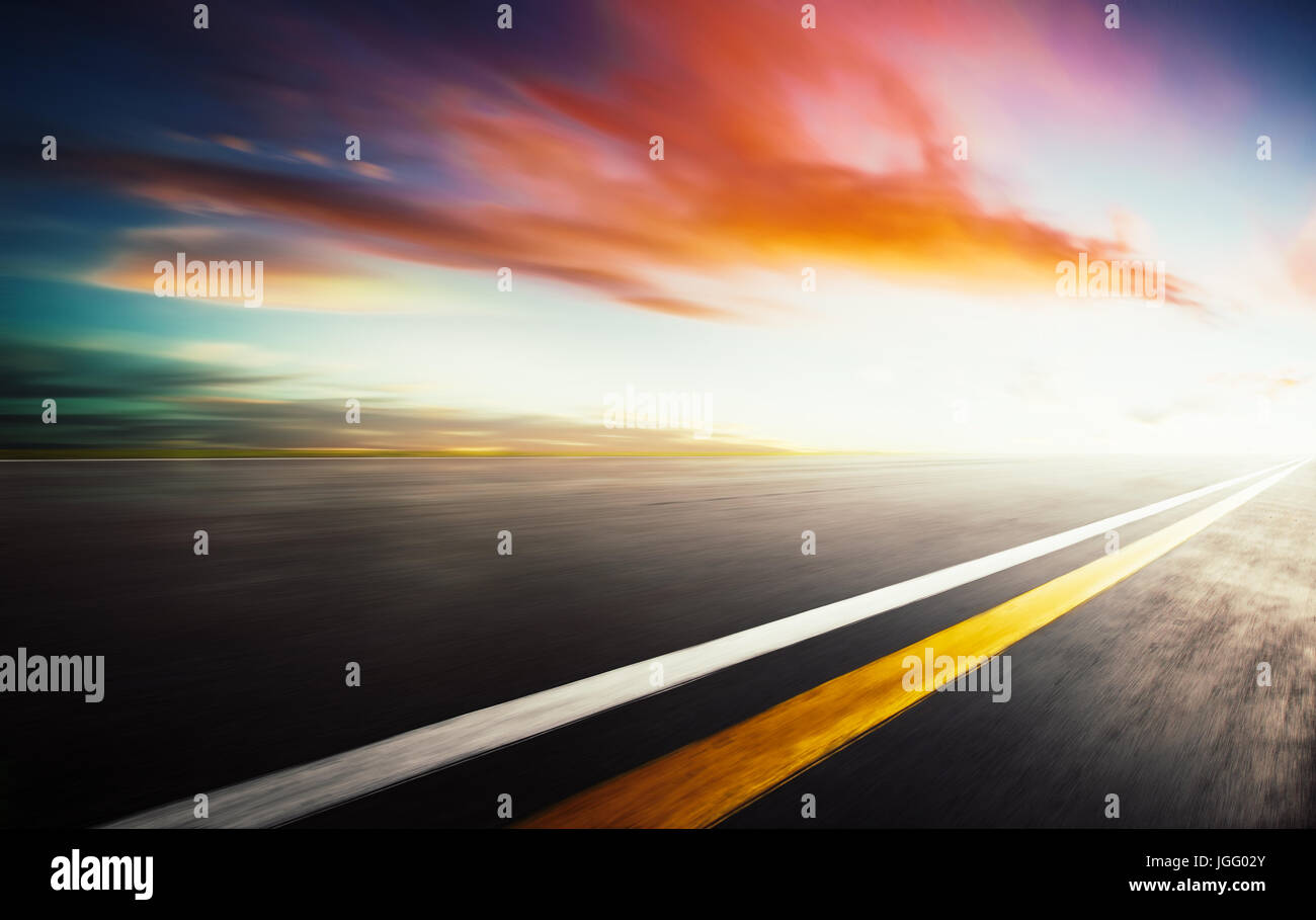 Motion blurred racetrack,warm mood - Stock Image