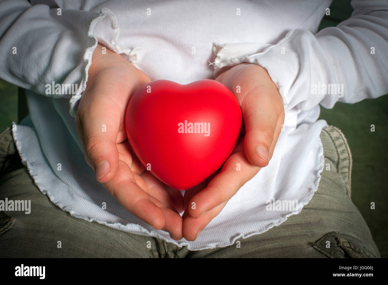 Heart in your hands. - Stock Image