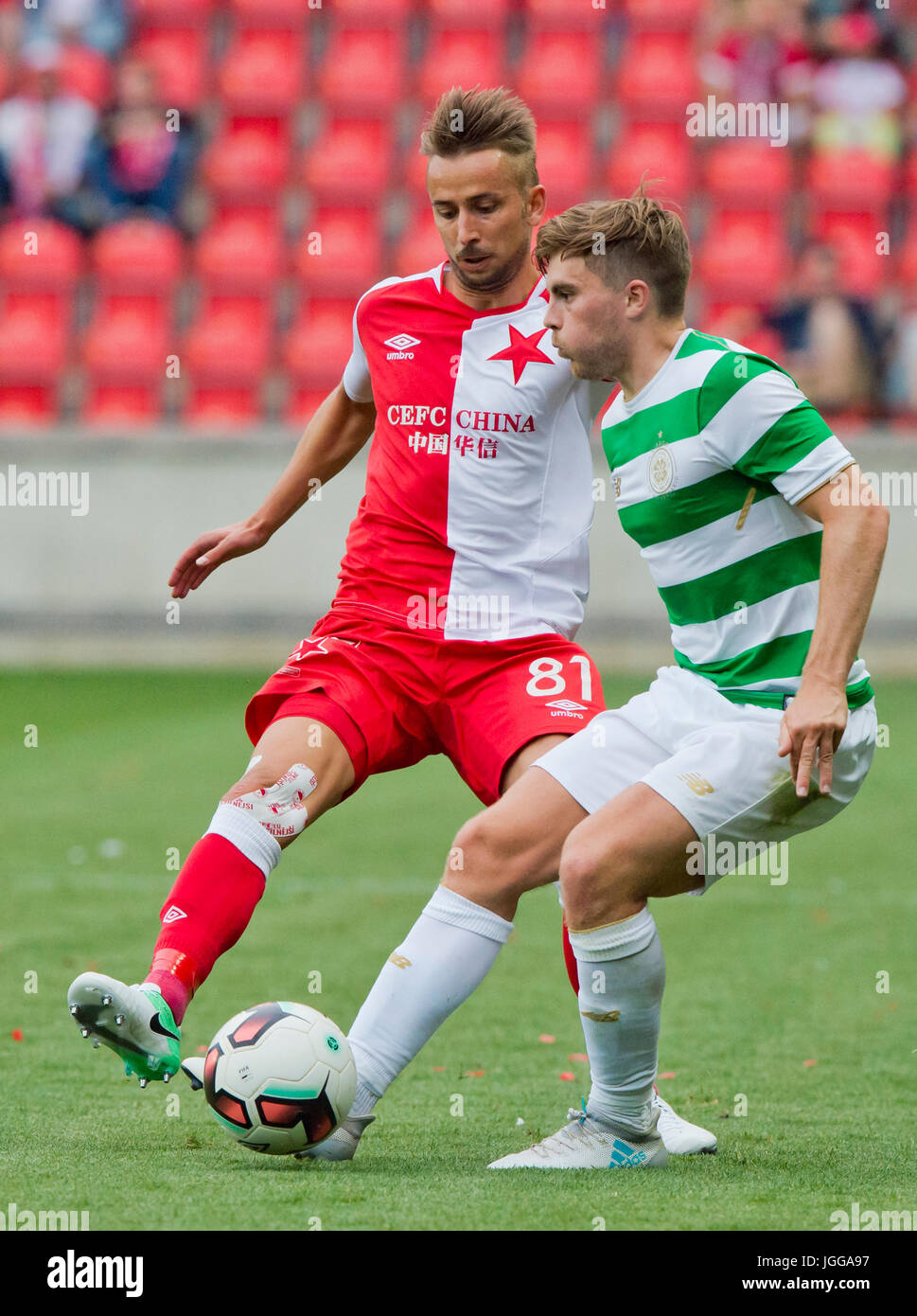 Prague, Czech Republic. 4th July, 2017. Dusan Svento of Slavia, left, and James Forrest of Celtic in action during - Stock Image