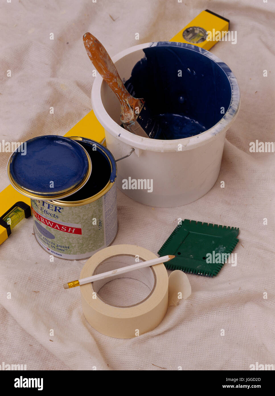 Tins of paint for painting renovated chest. Step x step shots of craft and diy projects - Stock Image