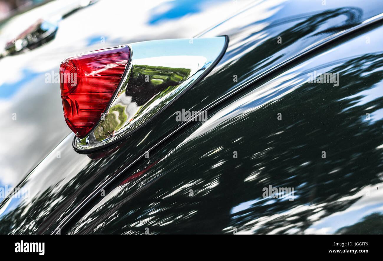 Tail lights of a green Jaguar XK 140 - Stock Image