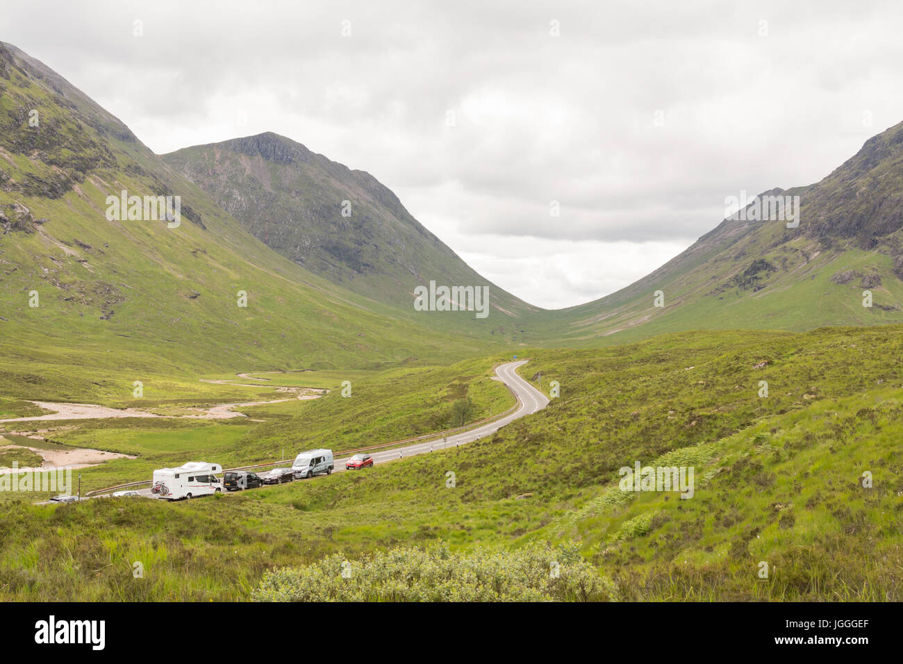 A82 trunk road, Glencoe, Scotland, UK - view from start of the Devil's Staircase walk with cars parked in layby - Stock Image