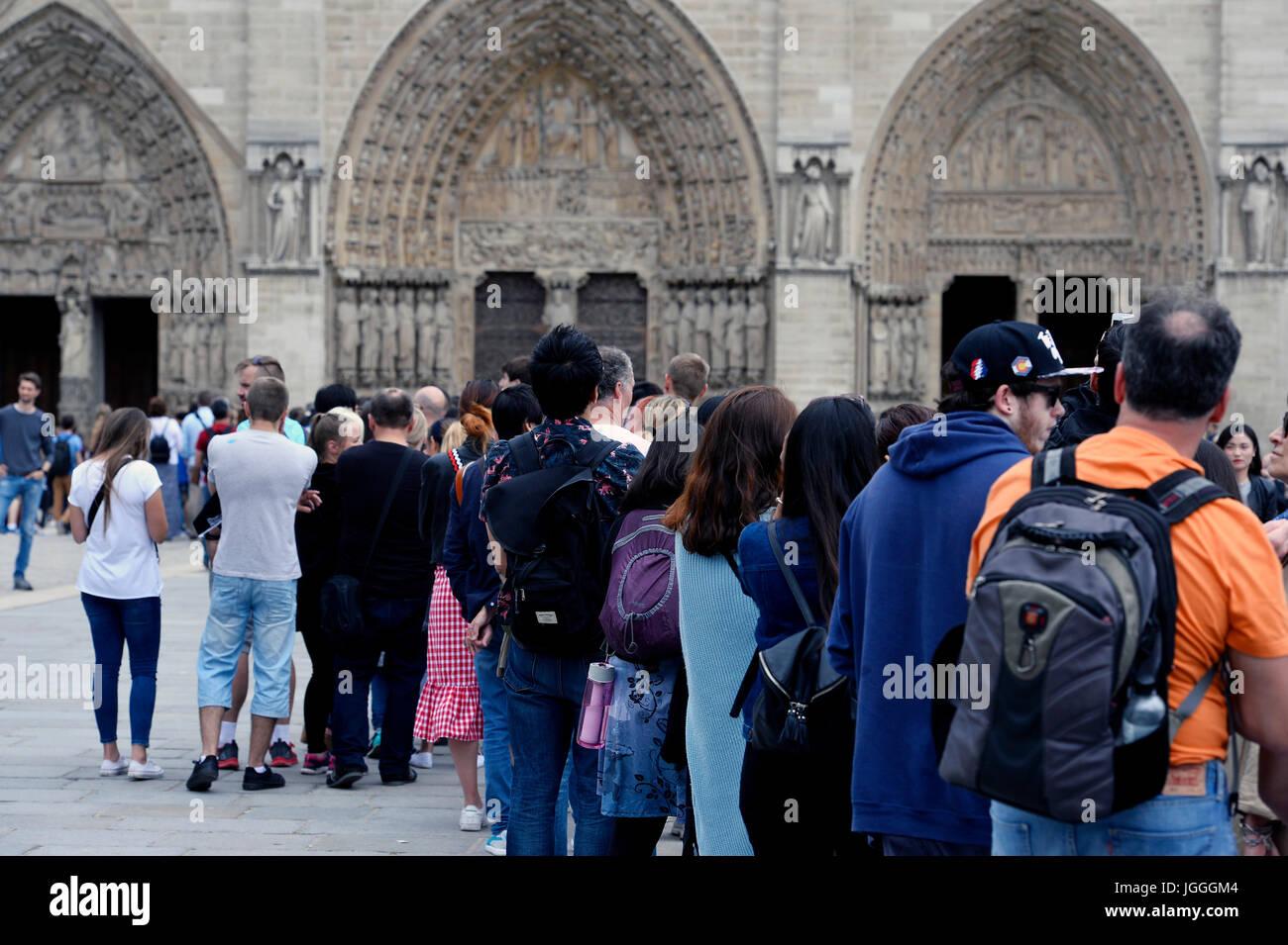 Tourists queue at Notre Dame, Paris, France Stock Photo