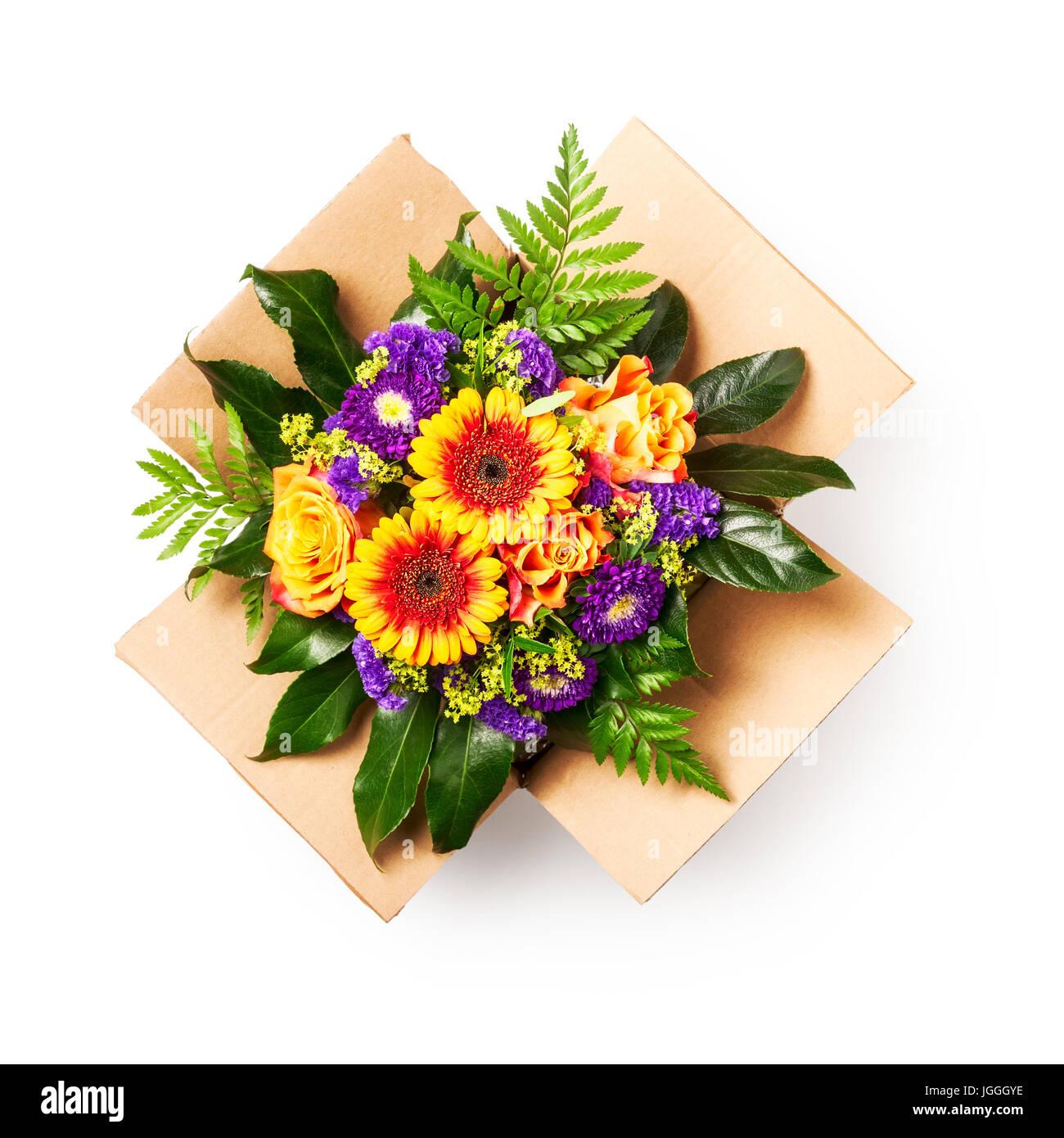 Flower delivery. Bouquet of rose and gerbera flowers in cardboard ...