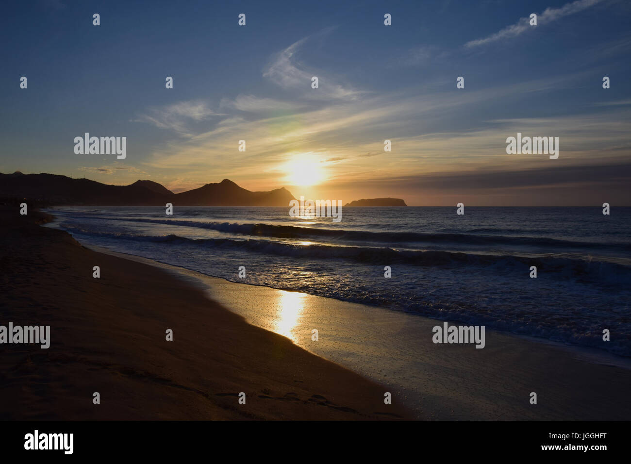 Sunrise over the headland of Porto Santo Beach, Madeira - Stock Image