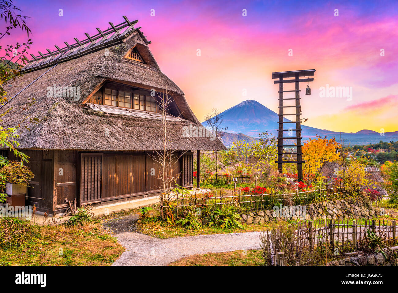 Mt. Fuji, Japan with historic village Iyashi no Sato during autumn - Stock Image