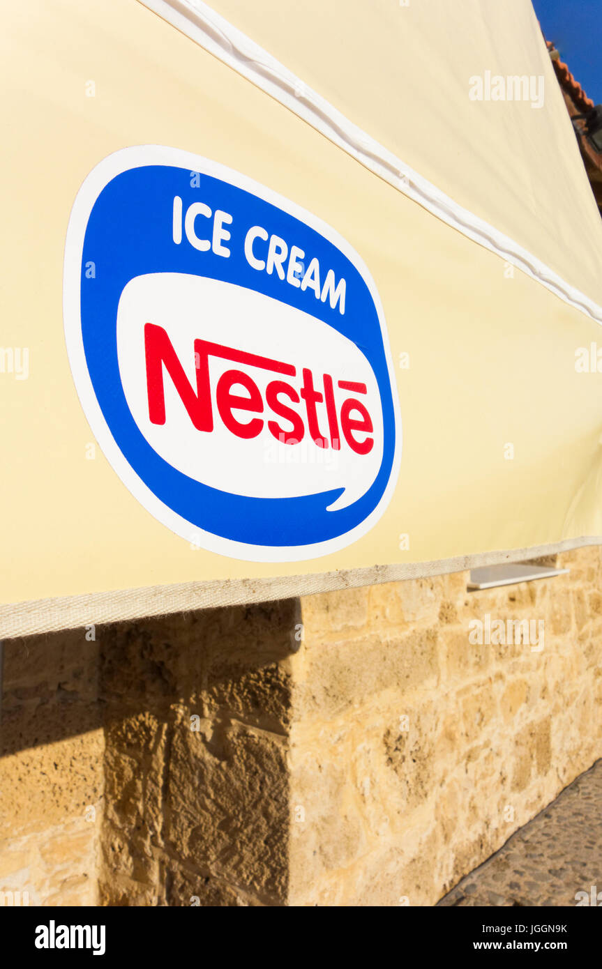 Paphos, Cyprus - November 13, 2013 Awning with Nestle Ice Cream logo in the street. - Stock Image