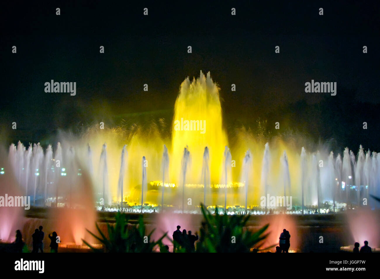 BARCELONA, SPAIN, APRIL 27,  2010. Visiting vivid colored fountain from Montjuic, Espagna Square. - Stock Image