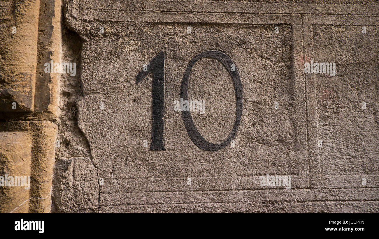 Addresses or street numbers on residential walls in Florence, Italy - Stock Image
