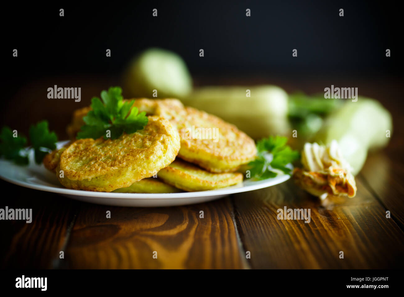 zucchini pancakes on a plate - Stock Image