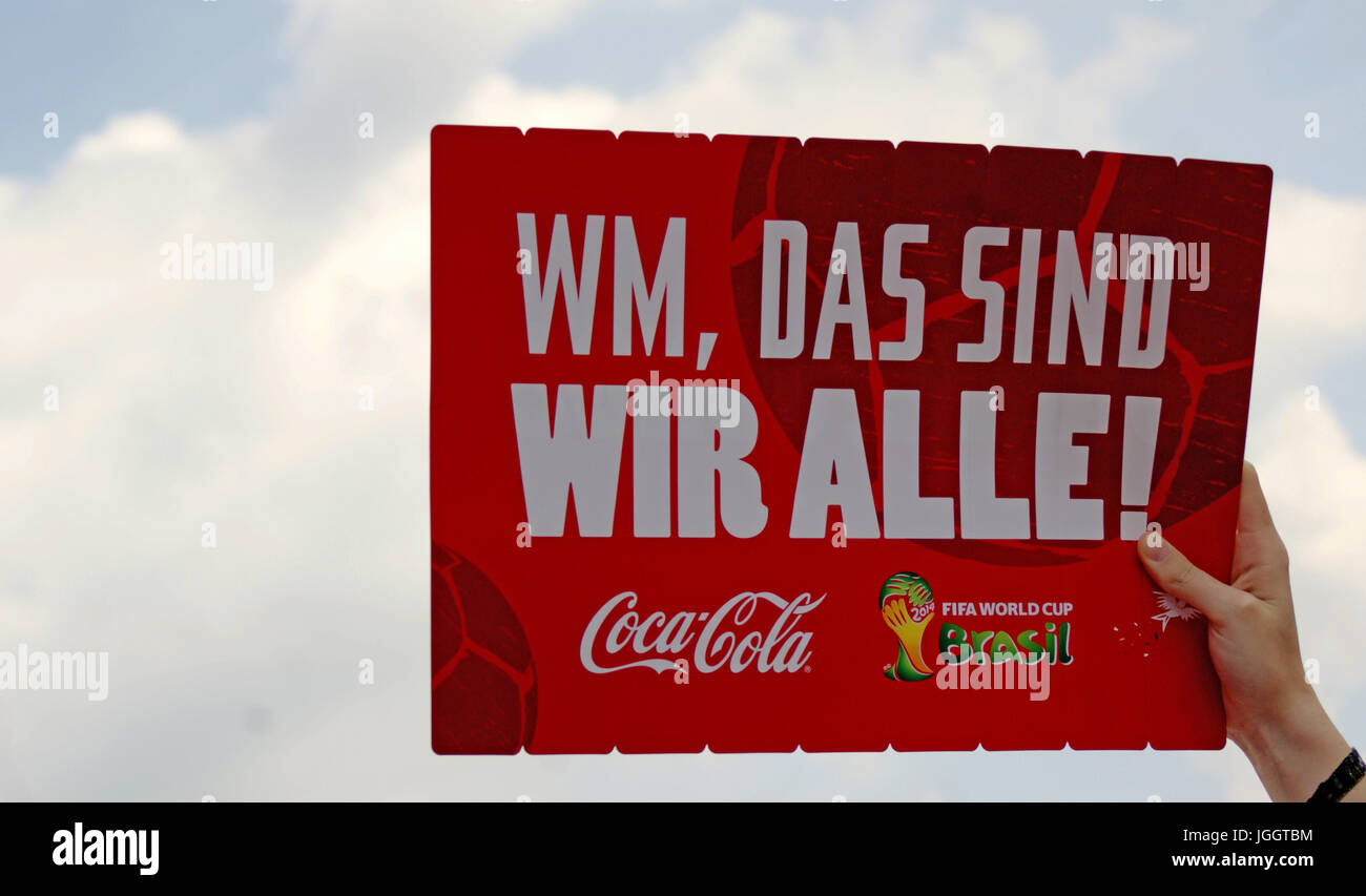 Hand holding up sheet expressing excitement for the German team winning the World Cup in 2015 at the Berlin, Germany - Stock Image