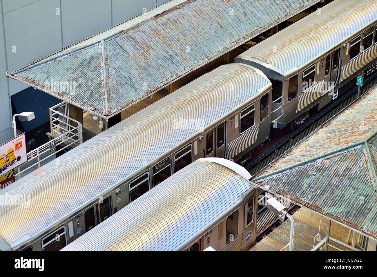 On tracks that gave rise to the term Loop in Chicago's famous downtown area, a pair of CTA rapid transit trains - Stock Image